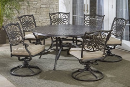 """Hanover TRADDN7PCSWRD6 7-Piece Tan Six Swivel Rockers Traditions Dining Set with 60"""" Round Cast-top Table"""